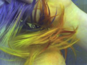 the base of the hair of the mohawk is now a yellow, rather than a blue or orange
